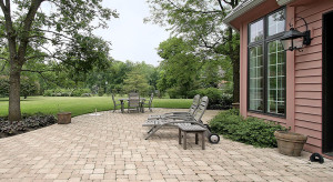 Brick patio in suburban home with furniture